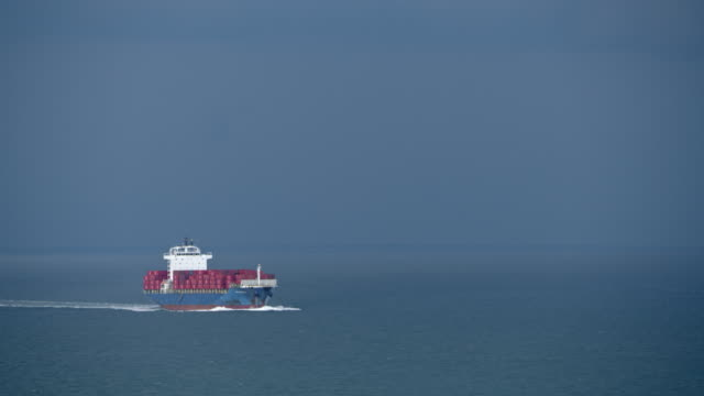 AERIAL Fully loaded container ship sailing the sea