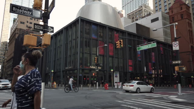 fulton center new york city designed by architect nicholas grimshaw exterior during coronavirus pandemic. street intersection of fulton street and... - time of day stock videos & royalty-free footage