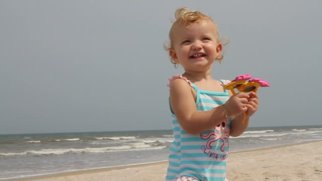 fun at the beach - babies only stock videos & royalty-free footage
