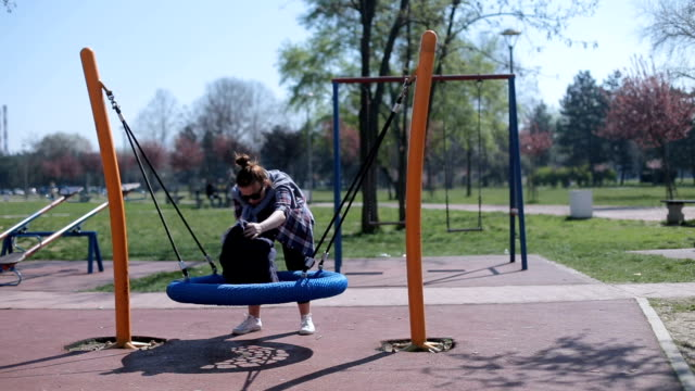 fun at the park on a swing - overweight child stock videos & royalty-free footage