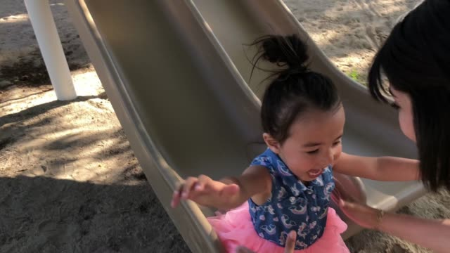 fun at the park with mom - sliding stock videos & royalty-free footage