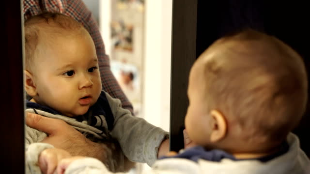 fun cute baby seeing self in mirror - mirror stock videos & royalty-free footage