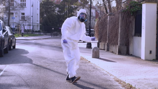 fun dance in full protective clothing during pandemic - scientific experiment stock videos & royalty-free footage