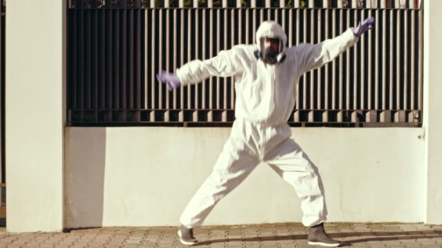 fun dance in full protective clothing during pandemic - comedian stock videos & royalty-free footage