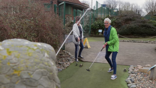fun day at mini golf - holing stock videos & royalty-free footage