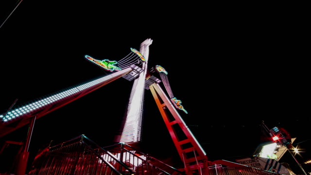 fun fair attraction at night - time lapse - swinging stock videos and b-roll footage