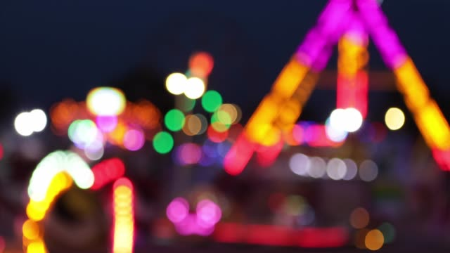 fun fair defocused - fairground stock videos and b-roll footage