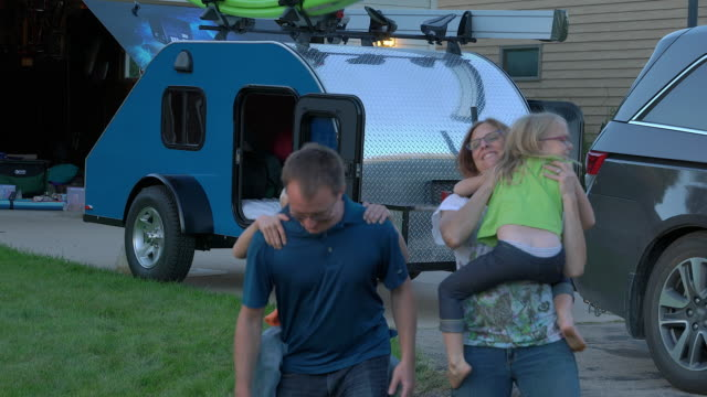 fun family portrait in front of camper - neenah stock videos & royalty-free footage
