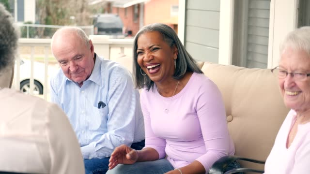 a fun group of active senior adults enjoy talking in senior living community - senior adult stock videos & royalty-free footage
