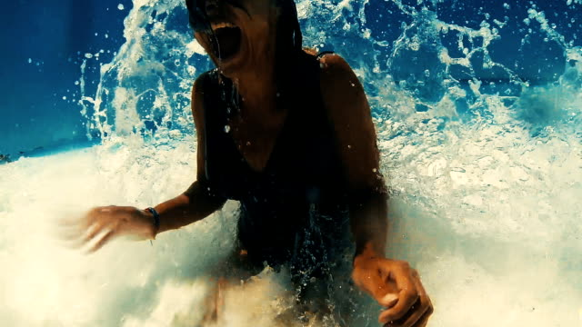 fun in crushing waves. - beach stock videos & royalty-free footage