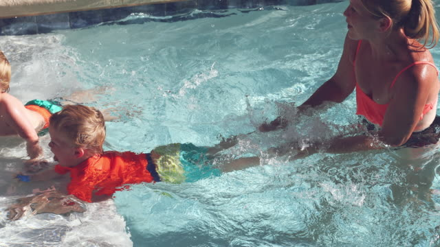 fun in the pool - identical twin stock videos & royalty-free footage