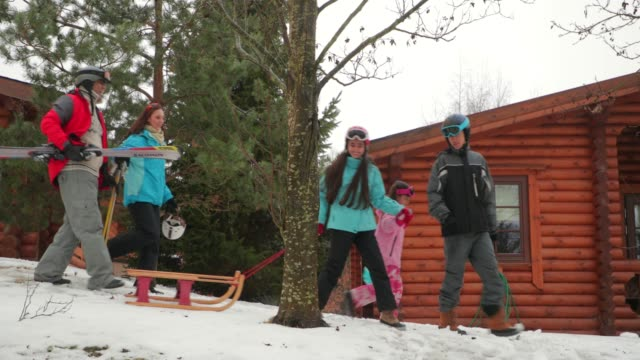 fun on the sled with their family - ski holiday stock videos & royalty-free footage