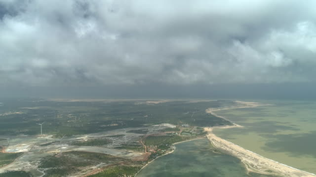 fun perspective with drone shot of moody sky and fluffy clouds hanging over lagoon in sri lanka - dappled light stock videos and b-roll footage