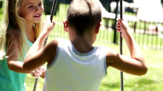 fun spinning on the swing - domestic garden stock videos & royalty-free footage