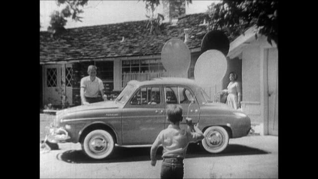 fun to own fun to drive fun to ride in says the announcer a young suburban american rides in their renault dauphine to the lake to a drivein... - 1960 stock videos & royalty-free footage