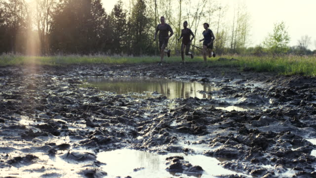 fun together - mud stock videos & royalty-free footage