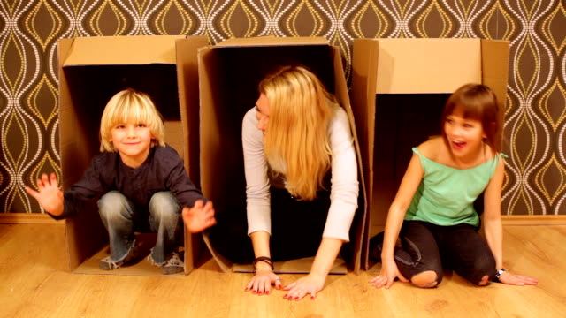 fun with cardboard boxes - hide and seek stock videos and b-roll footage