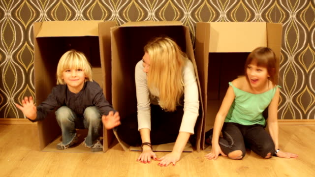fun with mom. hidden in boxes. - cardboard box stock videos & royalty-free footage