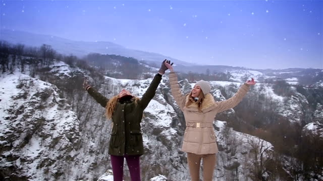 fun with my best friend on winter vacations on the top of the mountain - jumper stock videos & royalty-free footage