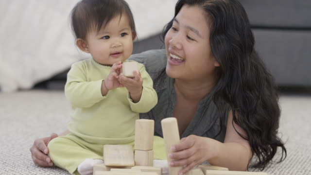 fun with toy blocks - fatcamera baby stock videos and b-roll footage