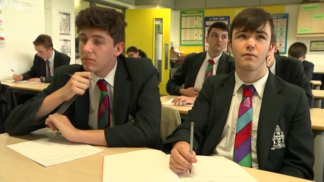 funding crisis means schools are losing thousands of teachers and classroom assistants england west sussex crawley int various shots teacher... - school uniform stock videos & royalty-free footage
