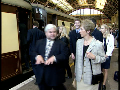 Fundraising campaign on QEII ITN ENGLAND London Victoria Station Lord Attenborough Elizabeth Dole standing chatting PULL OUT to Terry Waite with...