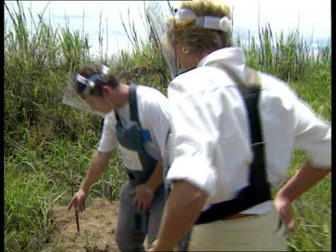 Fundraising campaign on QEII LIB ANGOLA Princess Diana walking thru minefield wearing protective gear
