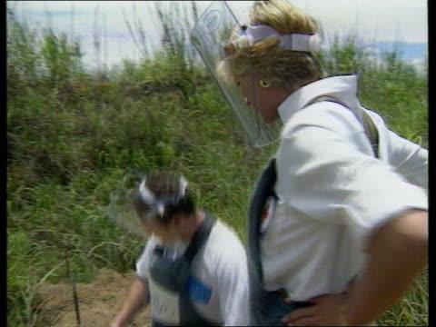 Fundraising campaign on QEII LIB ANGOLA Princess Diana walking thru minefield wearing protective gear LIB Princess Diana watching 13 year old girl...