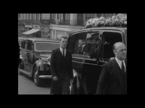 funeral and procession of kelso cochrane; england: london: ladbroke grove: ext hearse and procession along - used as bg story - 1950 stock videos & royalty-free footage