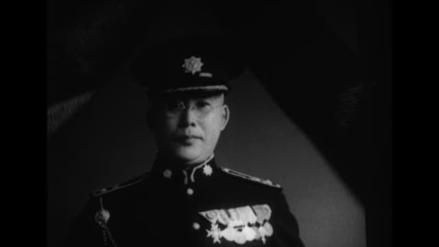 A funeral car mourners police forces and a band march through the streets to honor the assassinated Akagi Chikayuki assistant commissioner of the...