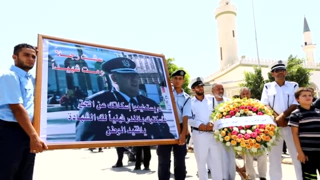funeral ceremony for the colonel mohamed alsuissi chief of police in tripoli was assassinated by unidentified attackers is held in tripoli libya on... - trauerzeit stock-videos und b-roll-filmmaterial