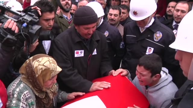 A funeral ceremony is held for police officer Ali Aksoy who was martyred in the twin deadly terror attacks in Istanbul on December 12 2016 in Akhisar...