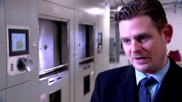 'environmental fees' add to costs for grieving families uk gloucestershire cheltenham interiors of crematorium including cremator ben jenkins... - gloucestershire stock videos and b-roll footage