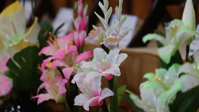Funeral flower arrangements are displayed at a booth at the Life Ending Industry Expo in Tokyo Japan on Tuesday Dec 8 Artificial funeral flowers with...