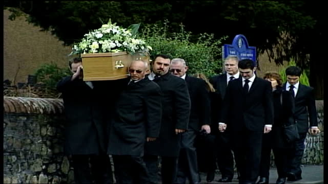 funeral for murdered backbacker katherine horton; wales: cardiff: llanishen: ext gv katherine horton's coffin being carried my mourners - murder victim stock videos & royalty-free footage