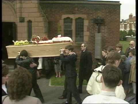 Funeral **** FOR ENGLAND Liverpool Christchurch Friends carry coffin to church Kenny Dalglish with mourners and Members of Liverpool team outside...