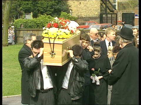 Funeral **** FOR ENGLAND Liverpool Christchurch Friends carry coffin into church grounds Kenny Dalglish with mourners Coffin carried into church...