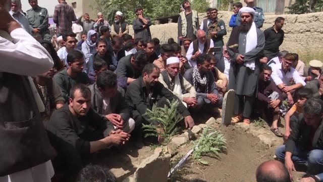 funeral is held for an afghan journalist killed in a suicide attack on a kabul wrestling club on wedneday that left at least 26 people dead - kabul stock videos & royalty-free footage