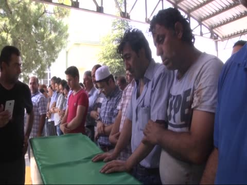 funeral is held for the people who died in a late night attack on a wedding ceremony that left at least 50 dead in gaziantep in southeastern turkey... - roped off stock videos & royalty-free footage
