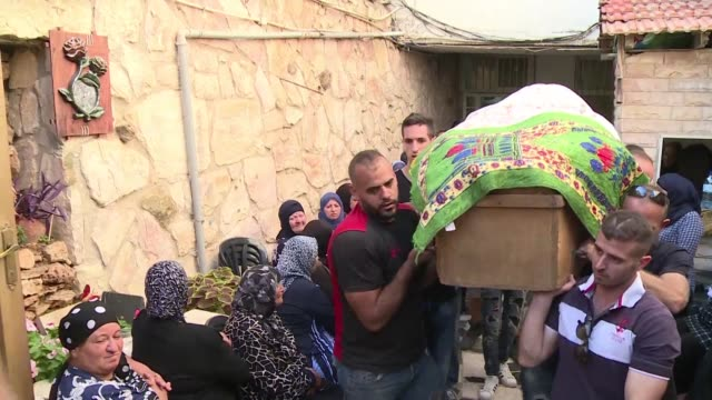 A funeral is held in Abu Gosh for Yosef Ottman the Israeli security officer who was killed along with two others in an attack by a Palestinian man in...