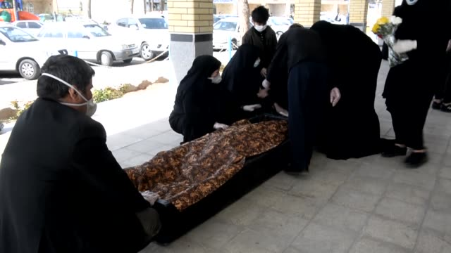 a funeral is held in qom city of iran on tuesday march 17 for two victims died from coronavirus in the countryfootage shows as a group of men carried... - iran stock videos & royalty-free footage