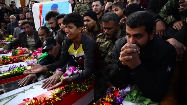 funeral is held in the holy shrine city of najaf for fighters of the saraya al-salam a shiite paramilitary force led by powerful shiite cleric... - najaf stock videos & royalty-free footage