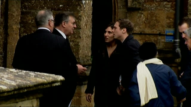 arrivals people arriving to attend the funeral service of actress lynda bellingham / wreath spelling out the word mum being carried into church /... - lynda bellingham stock videos & royalty-free footage