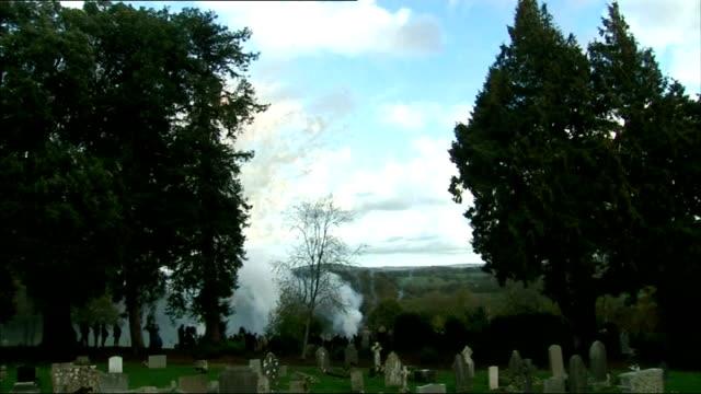 funeral of actress lynda bellingham back view coffin being carried fireworks being let off in cemetery - lynda bellingham stock videos & royalty-free footage