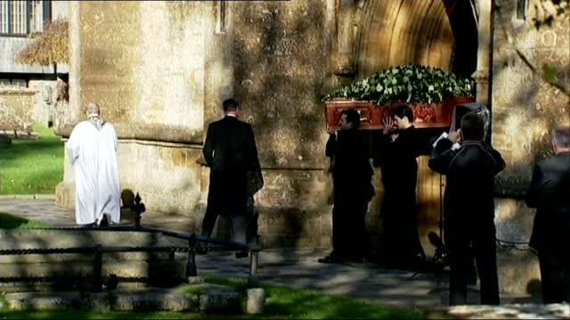 funeral of actress lynda bellingham coffin carrying bellingham being carried from church as music plays sot crowd of people applauding - lynda bellingham stock videos & royalty-free footage