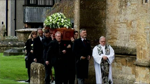 funeral of actress lynda bellingham england somerset crewkerne ext coffin carrying deceased actress lynda bellingham being carried into church - lynda bellingham stock videos & royalty-free footage