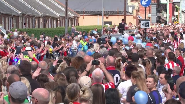 county durham blackhall colliery ext various shots of coffin of bradley lowery along in horsedrawn carriage past people lining street jermain defoe... - county durham england stock videos & royalty-free footage