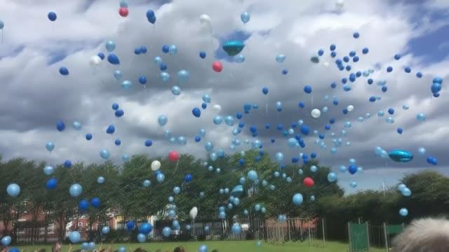 funeral of bradley lowery group of schoolchildren releasing balloons - releasing stock videos & royalty-free footage