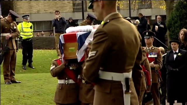funeral of british soldier killed in afghanistan; england: north yorkshire: skipton: ext funeral cortege of sergeant gareth thursby along past people... - skipton stock videos & royalty-free footage