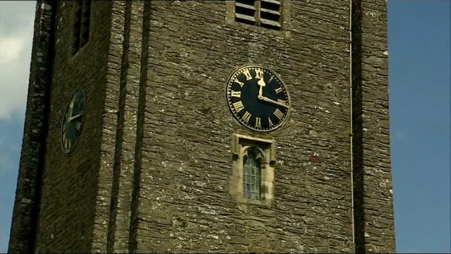 funeral of comedian rik mayall gv church tower with clock ruby wax arriving dawn french arriving and embracing man - dawn french stock videos & royalty-free footage